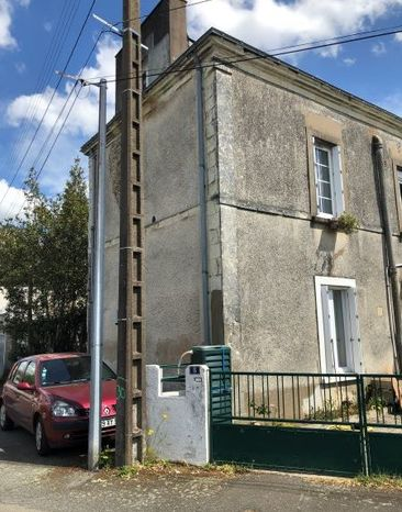 Restauration de façade à la chaux et pierres de Tuffeau